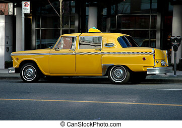 Old Style Vintage Taxi - An old style vintage yellow taxi on...