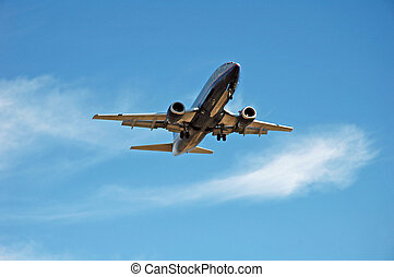 Airplane Landing - A jet plane coming in for a landing at an...