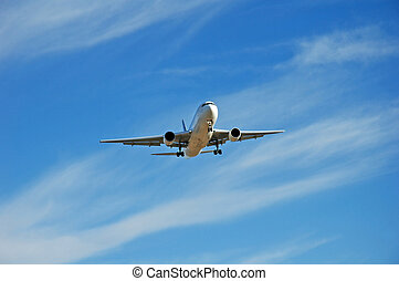 Jet Plane Landing - An airliner coming for a landing at an...