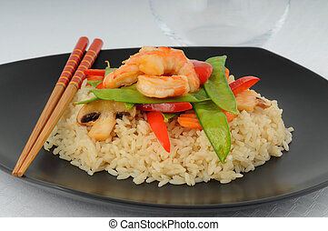 Shrimp Stirfry - Delicious shrimp and vegetables on white...