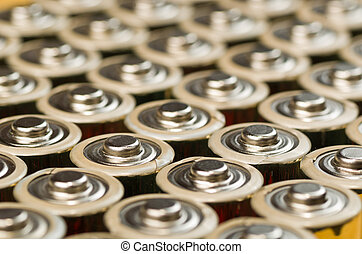 Batteries - Mutiple Gold Batteries in Rows with Silver Tops...