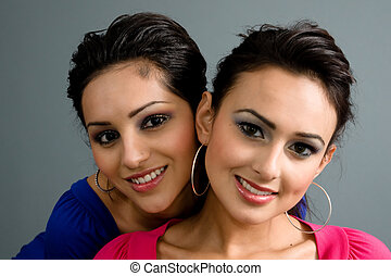 Latina Cousins - Two latinas with beautiful make up smile...