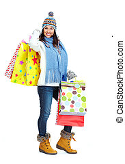 Beautiful shopping Christmas woman with bags.