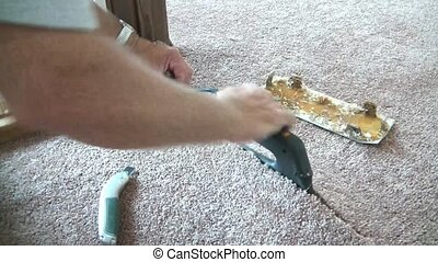 Ironing and Gluing Carpet Seams - Carpet layer uses a carpet...
