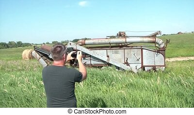 Man Taking Pictures of Rural Farm