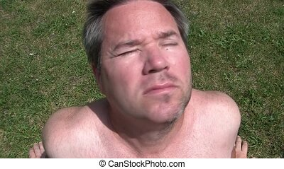 Guy with Half Shaved Beard Tanning - Man with half shaved...