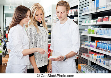 Pharmacist Assisting Female Shopper