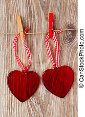 two hanging hearts - two red glass hearts hanging on rope