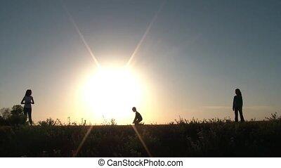 Kids Throwing Ball in Big Sun