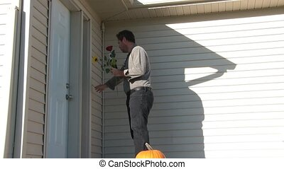 Man Brings Flowers to Door for Date - Man brings flowers and...