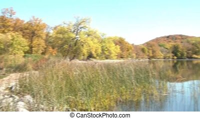 Lake in Fall Pan - Panning of a scenic lake in fall from...