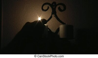 Lighting Candles in the Dark - Lighting brown candles in the...
