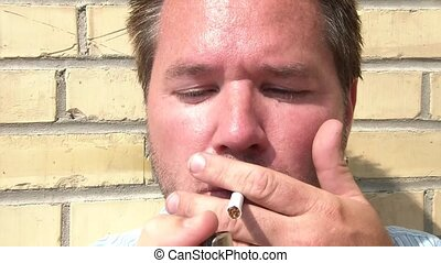 Man Smokes Cigarette Closeup - Businessman smokes a...