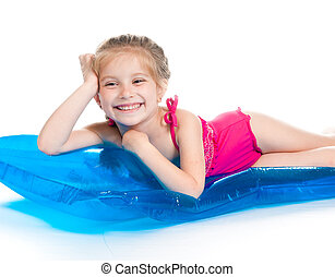 cute little girl on an inflatable mattress - cute little...