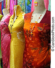 Traditional asian fabrics and clothes for sale in a shop in...