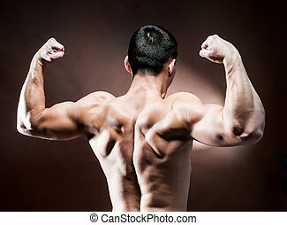 muscular male back on brown background
