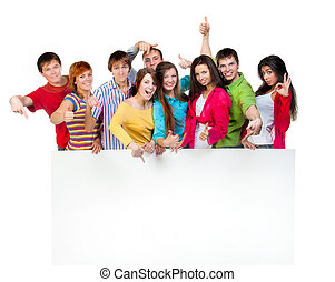 Happy young group of people standing together and holding a...