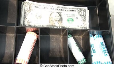 Open Cash Box - Breaking Coin Rolls - Hand opens metal cash...