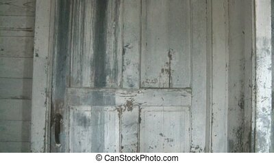Old Door Opens by Itself - Old barn farm door that is...