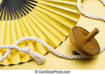 New Year decoration - Wooden spinning top and folding fan,...