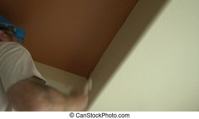 Painter Edges in Wall with Brush - Painter cuts in wall at a...