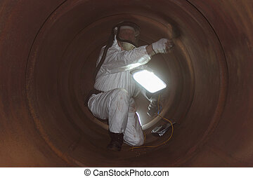 Furnace boiler clean - An engineer wearing ppe for a boiler...