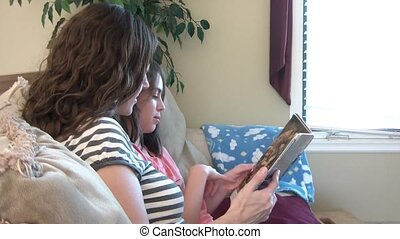 Mother and Daughter Read Together - Mother and daughter read...