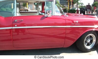 Pan of Brilliant Red Classic Car - Panning a brilliantly...