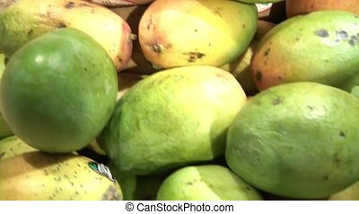 Mangos and Coconuts Pan - Pan of mangos and coconuts in...