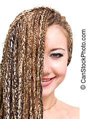 smiling young woman with dreadlocks - friendly smiling young...