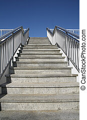Ascending Stairs Towards Blue Sky