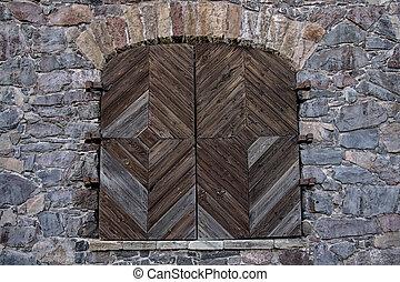 wooden door in a stone wall - Wooden door in the wall....