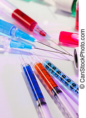 Many multicolor syringes, medical concept still life