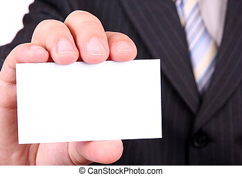 man is holding a business card