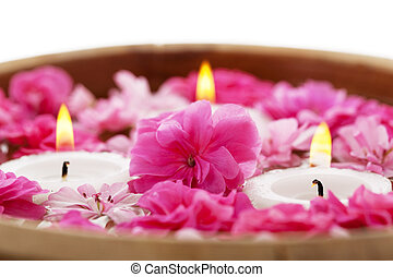Spa therapy, flowers in water with candles