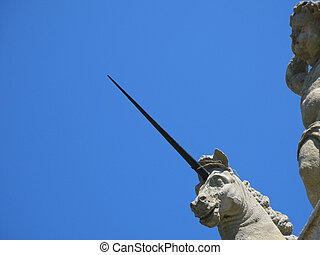 unicorn's head against a deep blue sky in Italy