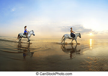 Picture a couple in love, which is galloping on a horse of...