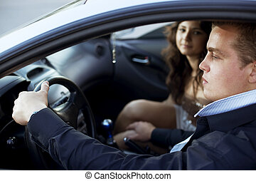 Harassment in the car - The image of a man put his hand on a...