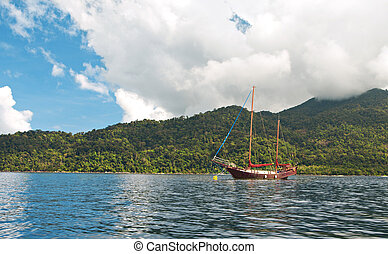 sailboat in tropical bay