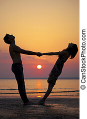 Two people in love at sunset
