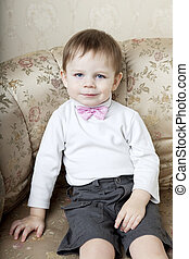 ?ute little boy on a background of vintage sofa - The image...