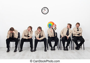 Stressed people waiting for a job interview - with a clown...