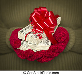 Woman Wearing Mittens Holding Stacks of Money with Red...