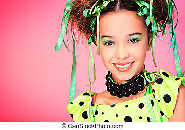 toothy smile - Portrait of a happy funny girl with holiday...