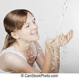 Girl splashing water - Image of girl, who splashing water on...