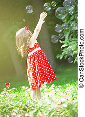 Cute little girl with bubbles - The image of a cute little...