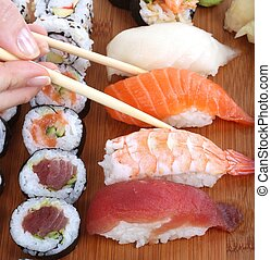 sushi and chopsticks close-up, food background