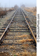 Railroad Tracks - Railroad tracks in perspective in a foggy...