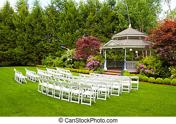 Wedding Venue and Chairs - A gazebo and white chairs at a...