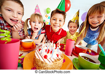 Birthday fun - Group of adorable kids gathered around...